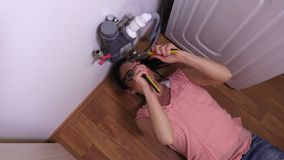 Woman try to start install a Kitchen Sink. Stock footage video stock video footage