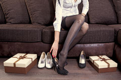Woman trying on black shoe stock photo