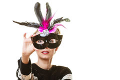 Woman trying carnival mask Royalty Free Stock Images