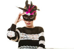Woman trying carnival mask Stock Image