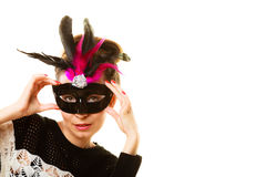 Woman trying carnival mask Royalty Free Stock Photo