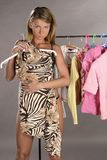 Woman trying on clothes Royalty Free Stock Photos