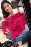 Woman trying clothes Royalty Free Stock Photo