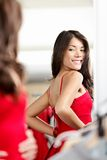 Woman trying clothes / dress Royalty Free Stock Image