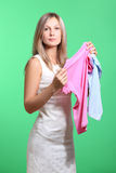 Woman trying clothing dress while shopping Royalty Free Stock Image