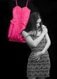 Woman trying a dress. Beautiful woman trying on a dress stock image