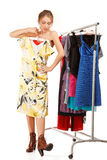 Woman is trying on dresses Royalty Free Stock Images