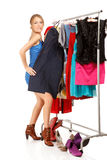 Woman is trying on dresses Royalty Free Stock Photos