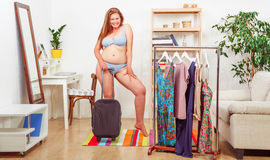 Woman trying dresses at home Royalty Free Stock Image