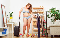 Woman trying dresses at home Stock Images