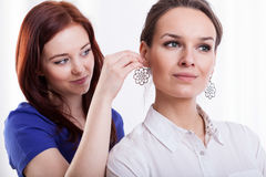 Woman trying on earring Royalty Free Stock Photography