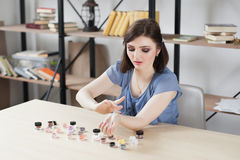 Woman trying eyeshadow colours on her hand Royalty Free Stock Photos