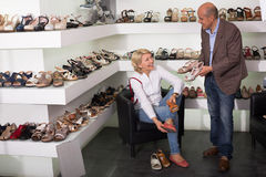 Woman trying on fashion shoes Royalty Free Stock Photo