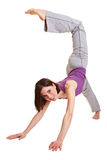 Woman trying a handstand. Young woman isolated on white trying a handstand Stock Photography