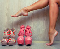 Woman trying on her shoes Stock Photo