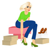 Woman trying many fashionable shoes. Attractive blonde woman trying many fashionable shoes Stock Photography