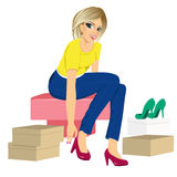 Woman trying many fashionable shoes Stock Photography