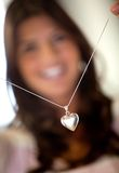 Woman trying a necklace Royalty Free Stock Photography