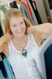 Woman trying on necklace in shop Royalty Free Stock Photo