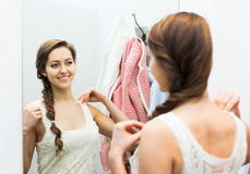 Woman trying on new blouse Stock Photo