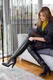 Woman trying on new boots Royalty Free Stock Photos