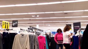 Woman trying new clothes stock video