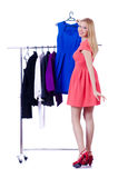 Woman trying new clothing. On white Royalty Free Stock Image