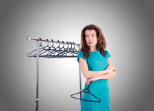 Woman trying new clothing. The woman trying new clothing against gradient Royalty Free Stock Images