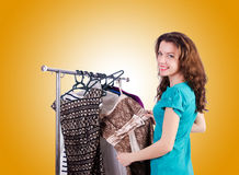 Woman trying new clothing against gradient Royalty Free Stock Image