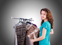 Woman trying new clothing against gradient Royalty Free Stock Images
