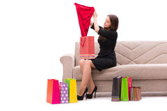 The woman trying new clothing sitting on sofa Stock Photo