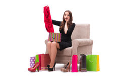 The woman trying new clothing sitting on sofa Royalty Free Stock Images