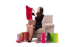 The woman trying new clothing sitting on sofa Stock Photos