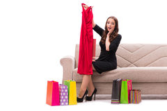 The woman trying new clothing sitting on sofa Royalty Free Stock Photography