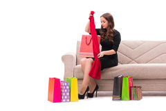 The woman trying new clothing sitting on sofa. Woman trying new clothing sitting on sofa Royalty Free Stock Photo