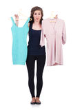 Woman trying new clothing Royalty Free Stock Photos