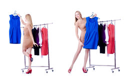 The woman trying new clothing on white. Woman trying new clothing on white Stock Image