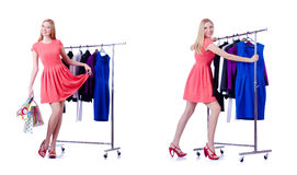 The woman trying new clothing on white. Woman trying new clothing on white Royalty Free Stock Images