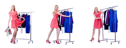 The woman trying new clothing on white. Woman trying new clothing on white Royalty Free Stock Image