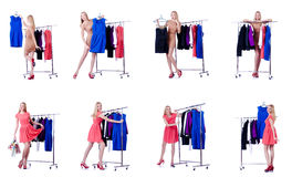The woman trying new clothing on white. Woman trying new clothing on white Stock Photo