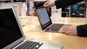 Woman trying new Macbook stock video