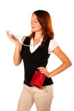 Woman trying a new necklace. Zoomed out shot. Beautiful red-haired woman trying a new gift - necklace. She is golding the gift box around her waist stock photos