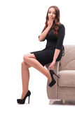The woman trying new shoes sitting on sofa Royalty Free Stock Image