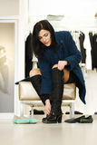 Woman trying out shoes Stock Images