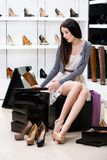 Woman trying on pumps in the shop Royalty Free Stock Photos