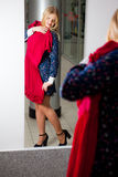 Woman trying red dress shopping for clothing Royalty Free Stock Images