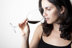 Woman trying red wine Royalty Free Stock Photo