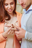 Woman trying ring on finger Stock Photo