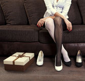 Woman trying on several shoes stock photos