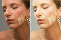 Woman trying shades of foundation on jaw Stock Photos